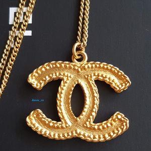 Chanel Matte Gold CC Pendant Necklace.